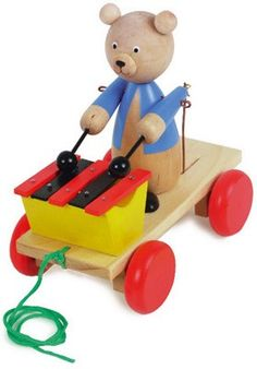Wooden Xylophone Bear - Cheeky pullalong bear rattles his xylophone whenever he is dragged along. Sturdy toy with a timeless design that has been around for generations.