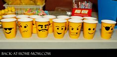 Free-handed Lego MiniFig Faces on Cups for the Lego Birthday Party