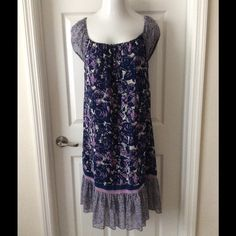 Jonathan Martin Dress This size 10 Jonathan Martin dress has a blue and purple floral print. It has been previously worn but is in great condition. It has short sleeves and a square neckline. Jonathan Martin Dresses Mini