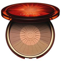 Clarins Summer Bronzing & Blush Compact ($39) ❤ liked on Polyvore featuring beauty products, makeup, cheek makeup, cheek bronzer, beauty and clarins
