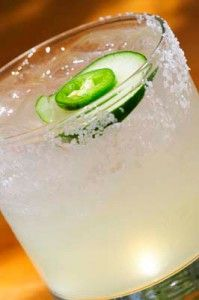 Cucumber and Jalapeño Margarita  1 whole lime, juiced  2 slices cucumber  1 slice jalapeño chile  3⁄4 ounce simple syrup  1½ ounces Tesoro Platnium Tequila  Additional slices cucumber and jalapeño for garnish  In a pint glass, muddle the cucumber, jalapeño, lime juice and simple syrup. Add the tequila and ice and shake. Finely strain into a rocks glass with ice. Garnish with the cucumber and jalapeño slices.