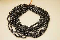 1strand  natural hematite plain rice sized 6 by 9mm by 3yes