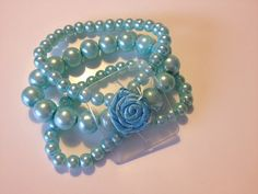 Add the flowers Tiffany Blue Corsage Wristlet by PetalandForrest on Etsy, $4.50 a