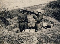 Two German soldiers using the American interwar export Colt Automatic Machine Rifle Model 1924 in 7.92×57 Mauser caliber, apparently adapted for light anti-aircraft use. Note the man at left is holding a spare 20-round magazine at the ready.