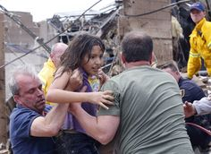 Sue Ogrocki / AP A child is pulled from the rubble of the Plaza Towers Elementary School in Moore, Okla., and passed along to rescuers after Monday's tornado. Oklahoma City, Oklahoma Tornado, Kansas, Building On Fire, Tornado Damage, Believe, Cool Mom Picks, National Weather Service, Tornadoes