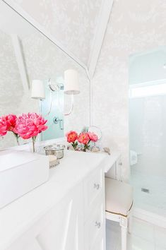 Alyssa Rosenheck - Katie Gibson Interiors - White bathroom features a white mirror adorned with Reed Single Sconces illuminating a white washstand fitted with x front cabinet doors and drawers adorned with nickel knobs topped with a rectangular vessels ink and cross handle vintage faucet.