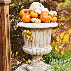 Pumpkin towers are the perfect Halloween pumpkin decoration. Stack pumpkins and gourds to spell words for a cute Halloween decoration trick-or-treaters will love, or decorate your pumpkin decor to match your own style. Outdoor Halloween, Fall Halloween, Halloween Halloween, Vintage Halloween, Halloween Makeup, Halloween Costumes, Pumpkin Planter, Pumpkin Garden, Autumn Decorating