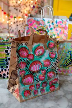 Never give a boring gift again - save paper bags and paint paint paint!   Painted Gift Bags - Aunt Peaches