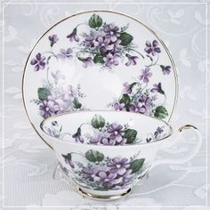 violets ~ this is so beautiful to me - I'm addicted to beautiful china and would have every set that I feel in love with if I were independently wealthy... but, as it is, I usually buy pieces at a time... ;-)