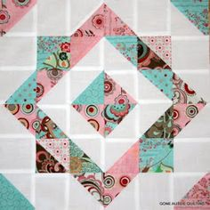 Half square triangle quilt block tutorial...blue square, gray center and points, coral corners.