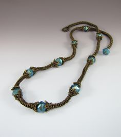 Rustic Rope from Melissa Shippe - PDF for herringbone necklace.  The bead caps are built into the rope links.  Easy  ~ Seed Bead Tutorials
