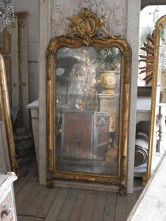 Fabulous old mercury mirror and gilt gesso frame.