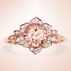 I like this rings design. I would switch out the Morganite for a center diamond. - Morganite Engagement Ring Vintage Lily Ring Unique Engagement Ring Leaf Ring Art Deco Ring Flower Ring Morganite Ring USD) by SillyShinyDiamonds. Leaf Engagement Ring, Morganite Engagement, Gemstone Engagement Rings, Vintage Engagement Rings, Ring Verlobung, Leaf Ring, Ring Dish, Pink Ring, Art Deco Ring
