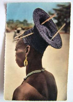 Africa | Postcard image of a Mangbetu woman, Belgian Congo. Posted 1953 || Published by Hoa Qui