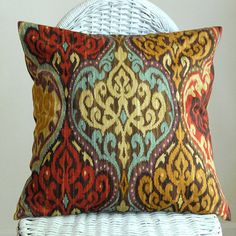 Damask red brown yellow and turquiose throw pillow from Etsy