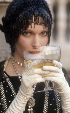 Mia Farrow as Daisy Buchanan - 1974 - The Great Gatsby - @~ Watsonette  We love this at LILY Magazine. Get the Gatsby look in your home with our story on Gatsby's Art Director and Costume Designer Catherine Martins collection with Mokum Textiles at  www.lifeandstyleonadime.com