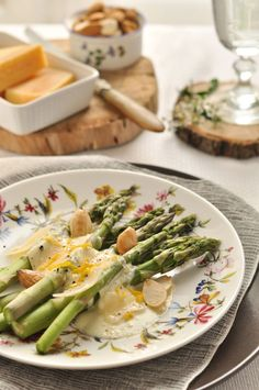 Delicious way to enjoy asparagus - roasted with Parmesan cheese sauce. Yum!
