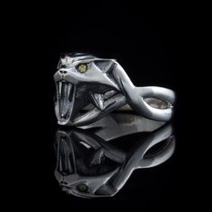 The design of this Cat School Witcher Ring is based on Ciri medallion. Ring is 100% handmade. Casted and polished with love. ◆Material: sterling silver, cubic zirconia (eyes, other colours are possible on demand). | eBay!