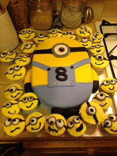 Minion cake! With mini minion buns! Perfect for 8 year old birthday party!
