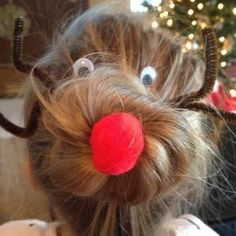 The Christmas Sock Bun: How to Do This Favorite Hairstyle With a Holiday Twist. So doing this next year for our annual tacky Christmas sweater party!