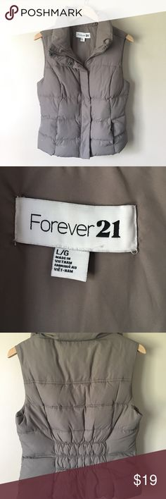 💞 Forever 21 Tan Down Vest. 💞 Warm and. Versatile Forever 21 down vest. This 10 vest has both zip and snap closures, side pockets and a gathered waist in the back.  Vest is like new!  A must have for your Fall and Winter fashion!  💞 Forever 21 Jackets & Coats Vests