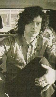 http://custard-pie.com/ Jimmy Page wired awake . . .  Robert Plant peacefully asleep behind. Very special pin! It is my pin, that was repinned by POSITIVE NOISE on Pinterest. PN is a website where you can purchase rare music. I am so proud!