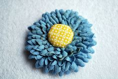 cute ric rac flower....felt backing and a covered button center