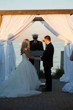 Gorgeous shot of this sunset ceremony on the shores of Lake Saint Clair | Photo: AAVA Photography | Infinity and Ovation Yacht Charters
