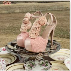 Pink t-strap heels with soft rosettes