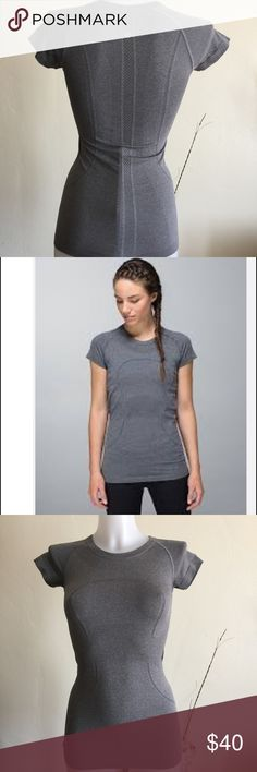 """Lululemon Swiftly Tech Short Sleeve Crew Sz 2 Lululemon Swiftly Short Sleeve Crew. Color Gray. Size 2 . Has minor piling however still great used condition. Light weight fabric. Material : 58% Nylon 38% polyester X-static Nylon. Has cute motivational quotes inside like  """" Do it Now'' """" I run for me """"... Please view all pictures carefully for full detail. lululemon athletica Tops Tees - Short Sleeve"""