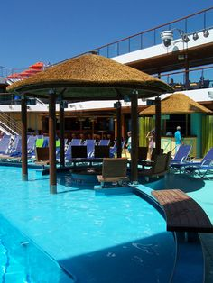 Carnival Breeze poolside-beautiful ship. I miss sitting here!