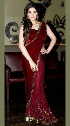 Zarine Khan wears a maroon sari from designer Archana Kocchar for a jewellery launch. Trendy Sarees, Stylish Sarees, Fancy Sarees, Party Wear Sarees, Pakistani Dresses, Indian Dresses, Indian Outfits, Saree Blouse Patterns, Saree Blouse Designs
