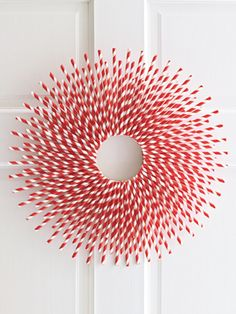 modern xmas wreath made out of red and white striped straws