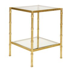 Gold leaf bamboo side tabe with clear glass tops.