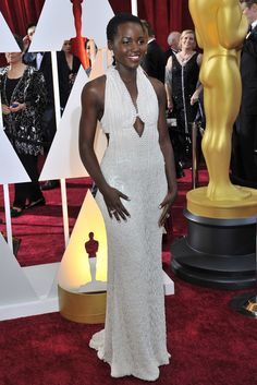 Lupita Nyong'o in Calvin Klevin Collection on the Oscars 2015 Red Carpet. [Photo by Donato Sardella]