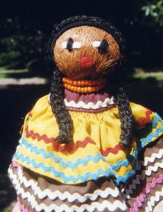 "Seminole Doll - More than just cloth-wrapped palmetto fiber husk stuffed with cotton, the Seminole Doll accurately portrays the clothing and hairstyle worn by traditional Seminole men and women. It is a favorite item of purchase at the many festivals and ""powwow"" events attended by Seminole vendors. The Seminole Tribe of Florida."