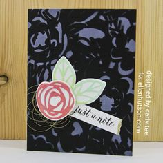 Black and white stenciled background with Ellen Hutson's Bold Blooms