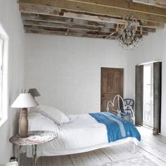 Shabby chic all white bedroom, bare beams, white painted wood floors