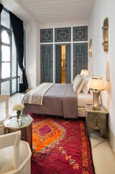 Nestled in one of the oldest neighborhoods of Marrakech, near the Medina, is Riad Adore. From the greyish blue metal and woodwork to the classic Moroccan architecture, this restored riad is filled with charm and reason why I need to Moroccan Room, Moroccan Interiors, Moroccan Decor, Moroccan Lanterns, Moroccan Tiles, Turkish Tiles, Portuguese Tiles, Bedroom Layouts, Bedroom Themes