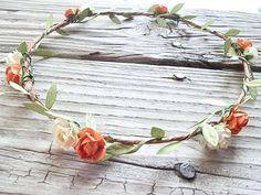 "This Majestic Blossom Flower Crown is simply stunning, in soft hues of Yellow, Orange and Ivory Delicately placed mini parchment roses on handmade rustic crown with garland Leafs. This Flower crown is the perfect addition for that special day. Simply Beautiful.....  Fits a 22"" head circumferenc..."