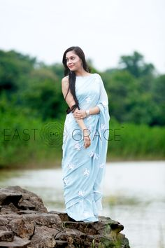 Featuring a soft powder blue pure silk chiffon saree with light white ribbonwork floral motifs embroidered all over it. PRICE: INR 15,499.00; USD 234.83 To buy please click here: https://www.eastandgrace.com/products/white-blue-birdies For help reach us at care@eastandgrace.com. With love www.eastandgrace.com