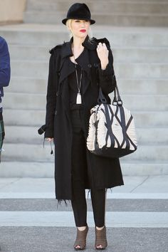 There is nothing easier to pull an outfit together with than a great trench coat. Case in point, Gwen Stefani to your left. Copy her look and team yours with a most excellent hat, too.