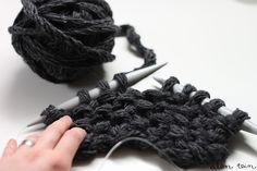 Make BIG yarn by finger-knitting regular yarn, and then knitting that.