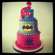 3 tiers top superman middle batman bottom watchmen dc comic wedding cake oh yea with the traditional bride and groom on top (maybe)