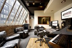 Wonderful view of the city architecture through slanted huge Loft style windows of this professional music studio. -cSw:) > http://www.pinterest.com/claxtonw/