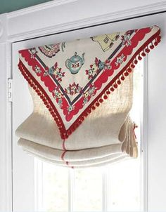 """From Country Living, photo by Steven Randazzo. """"A vintage tablecloth with pom-pom fringe becomes a cheerful topper to a kitchen door window treatment. Read more: Window Treatments - Draperies and Curtains - Country Living """" Window Toppers, Kitchen Window Treatments, Curtain Styles, Kitchen Doors, Window Coverings, Victorian Homes, Windows And Doors, Retro, Country Living"""