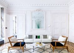 """House tour: a New York family's Parisian holiday home: The apartment also fits another of their prerequisites — to be quintessentially French. """"When you come here on vacation, you want to walk in the door and immediately say to yourself, 'This is France,' """" she asserts. It is located in a stately 1830s building that for decades belonged entirely to descendants of the French poet Paul Valéry, and has all of those highly sought-after Parisian architectural details: marble fireplaces, pane..."""