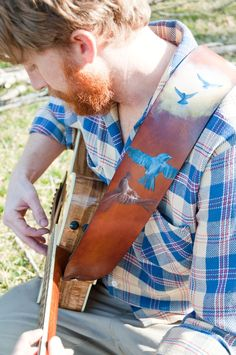 Hand painted leather guitar strap..the boys pretty cute :)