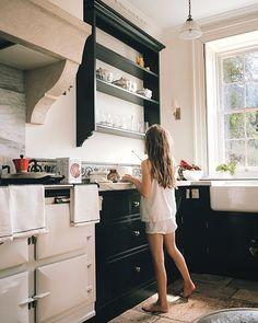 Ten-year-old Ursula, in Petit Bateau pajamas, in the farmhouse kitchen.