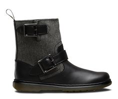 Our Casual collection takes simple design and fuses it with retro influences and unexpected finishes. The very English-style tweed on the Gayle biker boot is inspired by Hobo elements of Buffalo design, popularized by stylist Ray Petri in the 1980s. The warm material contrasts sharply with the clean shine of the leather while chunky buckles and a leather spine give these boots some serious personality.